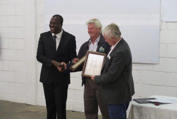 Mr. Sebastian Zuze handing ISO certification to director Pete Simpson
